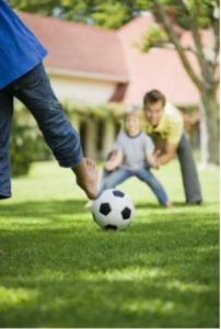 Active child kicking a ball